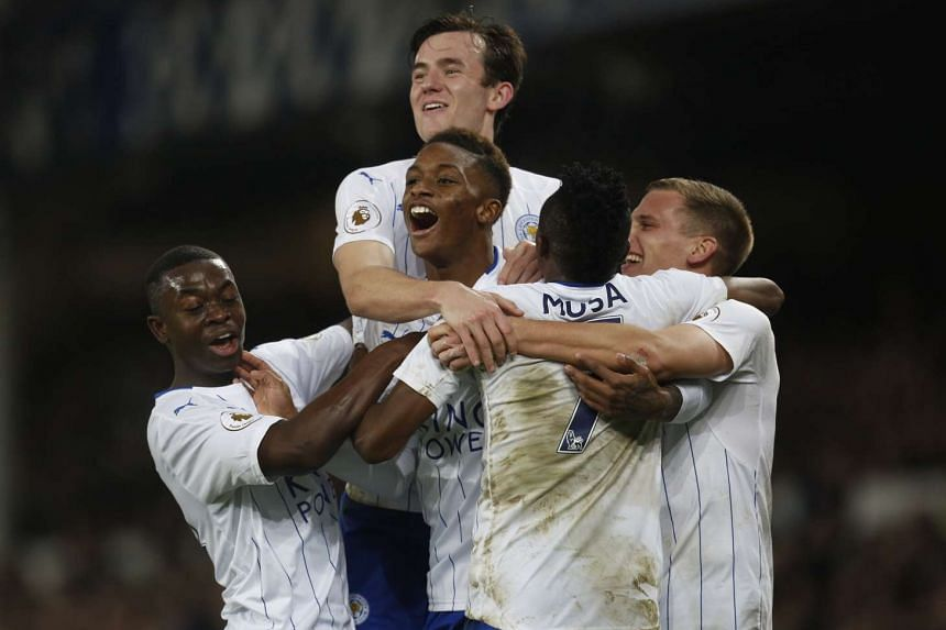 Leicester City's Ahmed Musa celebrates scoring their first goal with team mates.