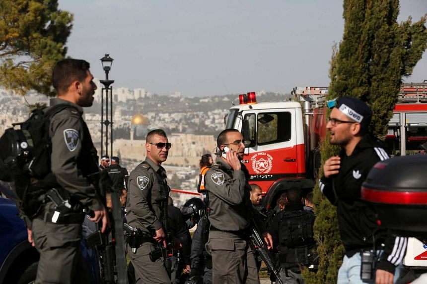 Israeli security forces work at the scene of a truck ramming incident in Jerusalem on Jan 8, 2017.
