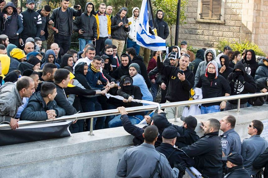 Right wing supporters protest outside the defence ministry in Tel Aviv on Jan 4, 2017, in support of Israeli soldier Elor Azaria.