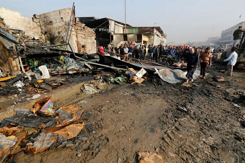 People gather at the site of a car bomb attack at a vegetable market in eastern Baghdad, Iraq on Jan 8, 2017.