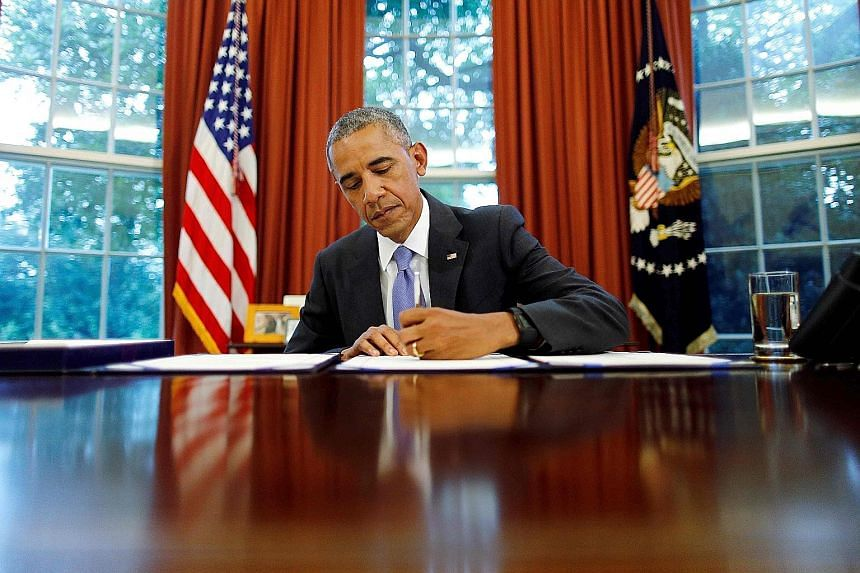 Above: While Mr Obama signed many laws, the cloud hanging over his legacy is this: Can a president still be considered great if he has nothing to show for it - if his achievements are dismantled by the man who comes after?