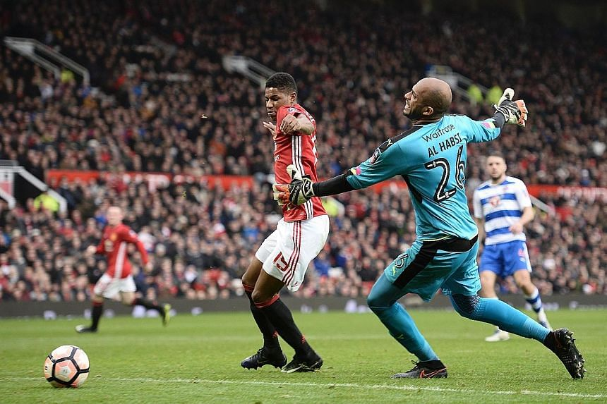 Striker Marcus Rashford dispossessing Reading goalkeeper Ali Al-Habsi after a back pass to score United's fourth, as the holders opened their FA Cup defence superbly.