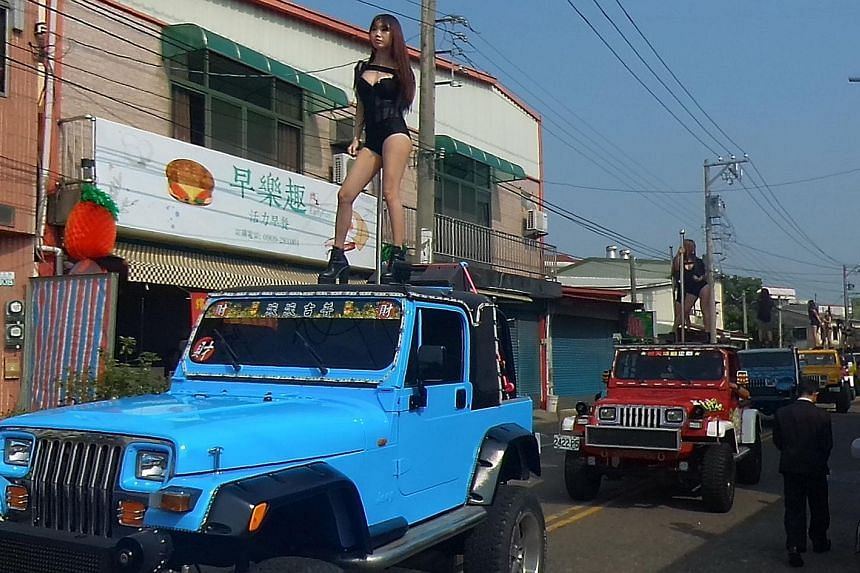 The funeral procession of local councillor Tung Hsiang in Chiayi, southern Taiwan, stretched for several kilometres and featured 200 vehicles and 50 pole dancers.