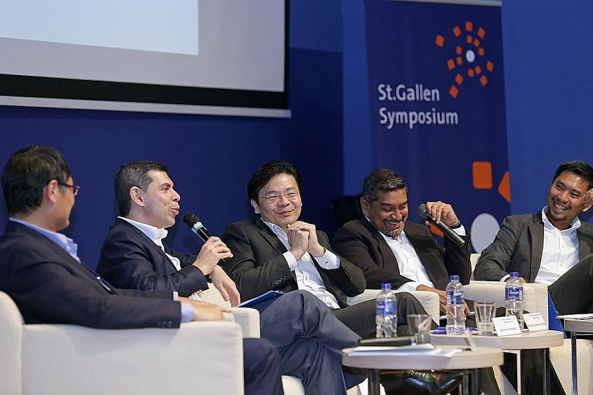 On the panel at the symposium yesterday were (from left): Dr Tan Chi Chiu, Mr Warren Fernandez, Mr Lawrence Wong, moderator Viswa Sadasivan, who is chief executive of Strategic Moves and a former Nominated MP, and Mr Martin Tan.