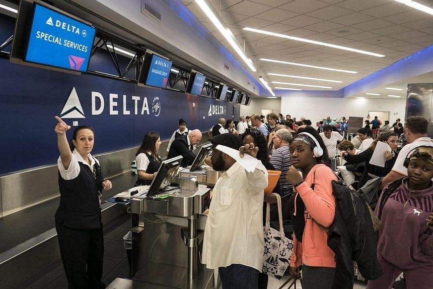 Delta airlines' staff help customers as services resume after the shooting that left five dead at Fort Lauderdale's airport, in Florida, US on Jan 7, 2017.
