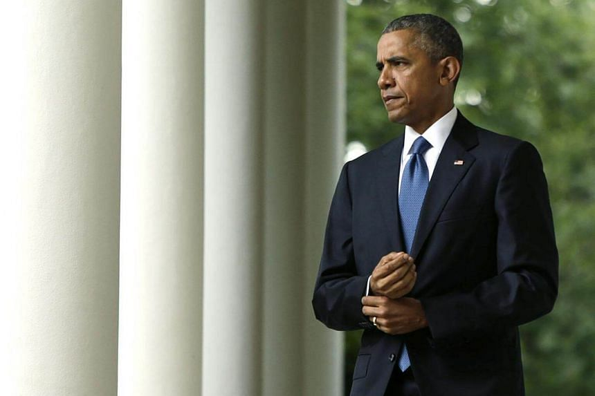 US President Barack Obama walks out of the Oval Office to comment on the Supreme Court ruling on the constitutionality of same-sex marriage, at the White House in Washington on June 26, 2015.