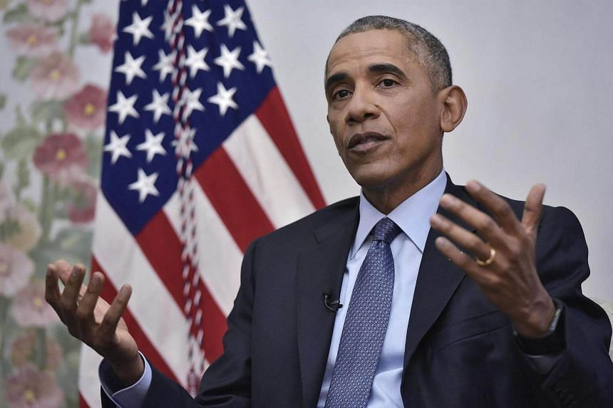 US President Barack Obama taking part in an interview with Vox's Ezra Klein and Sarah Kliff in Blair House on Jan 6, 2017 in Washington, DC.