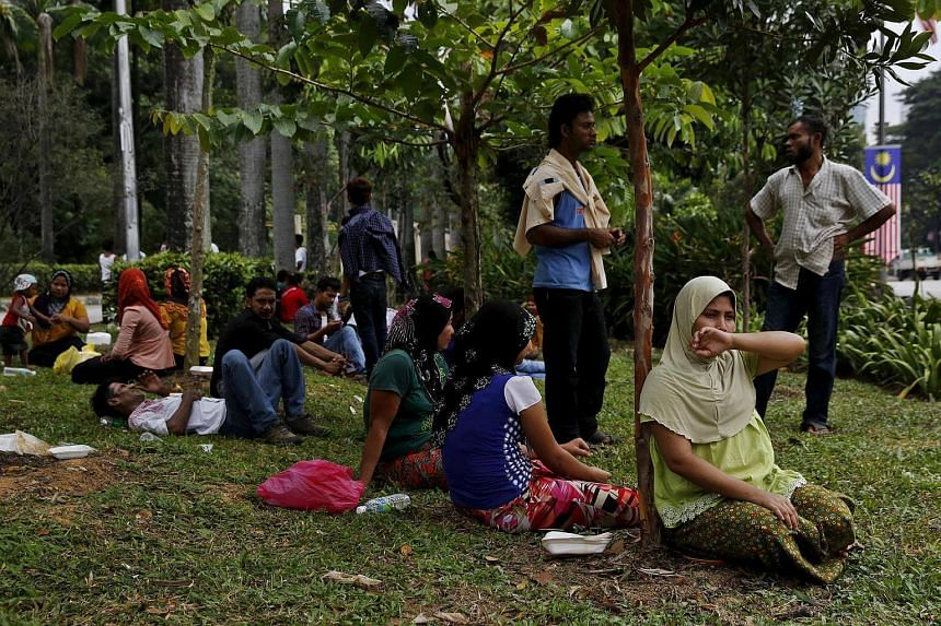 Refugees, many of whom say they are Rohingya, wait for access to the United Nations High Commission for Refugees (UNHCR) building in Kuala Lumpur, Malaysia, on Aug 11, 2015.
