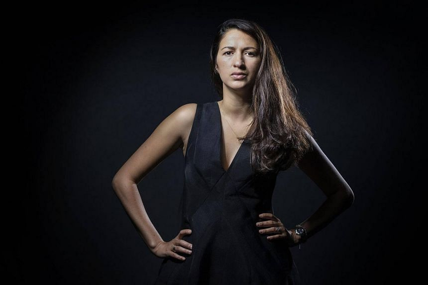 French-Maroccan journalist Zineb El Rhazoui and former columnist at the French satirical weekly Charlie Hebdo, posing during a photo session in Paris.
