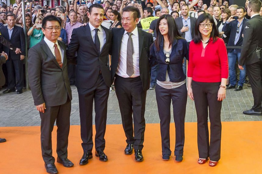From left: Valencia board director Koh Kim Huat, former president Amadeo Salvo, owner Peter Lim and his wife Cherie, and club president Chan Lay Hoon outside the Mestalla Stadium in 2014. Lim was attending his first game after winning the bid to take over