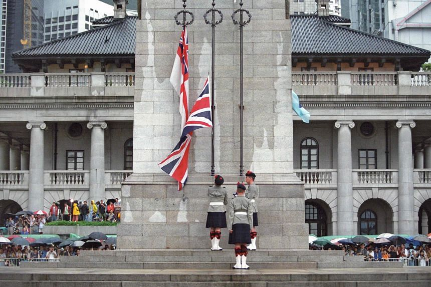 British soldiers lowering their country's flag for the last time at the Cenotaph monument in Hong Kong on June 30, 1997.