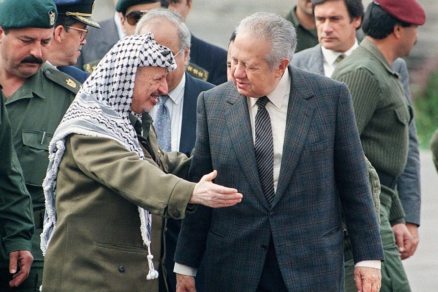 This file photo taken on Jan 17, 1996 shows Palestinian leader Yasser Arafat (L) welcoming Portuguese president Mario Soares in Jericho.