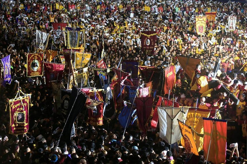 The carriage carrying the Black Nazarene making its way through people as it is pulled by devotees during an annual procession in Rizal park, metro Manila, Philippines, on Jan 9, 2017.