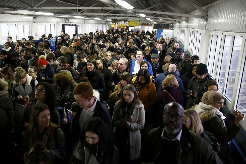 Commuters queueing up for trains at Clapham Junction during a strike in London on Jan 9, 2017.