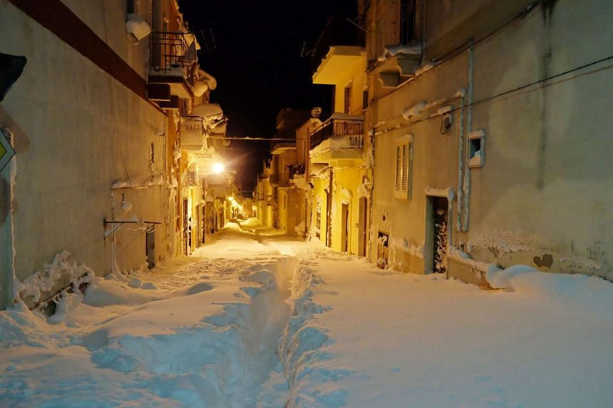 A street is covered by snow in Santeramo in Colle on Jan 8, 2017 after snowfalls near Bari, in the Puglia region of southern Italy.