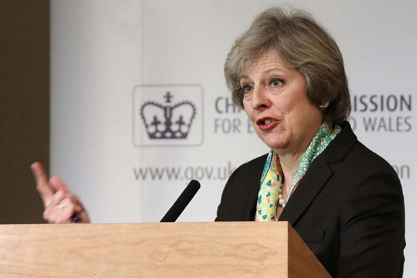 British Prime Minister Theresa May speaks during an address to members of the Charity Commision for England and Wales at The Royal Society in central London on Jan 9, 2017.