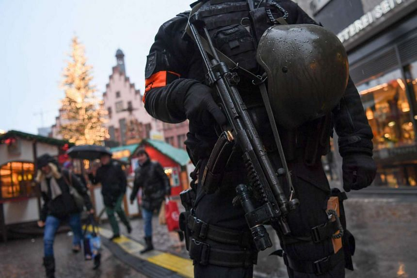 A policeman standing guard at a Christmas market in the centre of Frankfurt am Main, western Germany, on Dec 22, 2016. Germany's domestic security chief warned that the country's radical Islamist scene was growing and posed greater challenges to surv