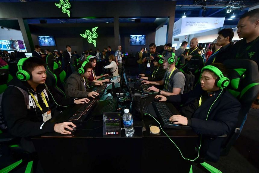 Gamers play Overwatch by Blizzard using hardware from Razer during the 2017 Consumer Electronics Show (CES) in Las Vegas, Nevada, on Jan 6, 2017.