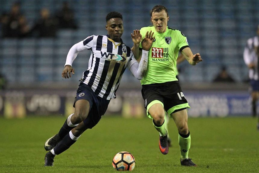 Millwall's English midfielder Fred Onyedinma (left) vying with Bournemouth's Australian midfielder Brad Smith during the English FA Cup third round football match between Millwall and Bournemouth at The Den in London on Jan 7, 2017.
