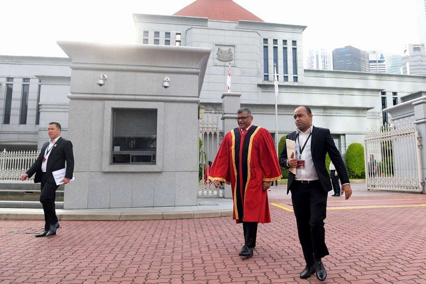 Chief Justice of Singapore Sundaresh Menon walking out of Parliament House for the group photo during the opening of the Legal Year 2017.