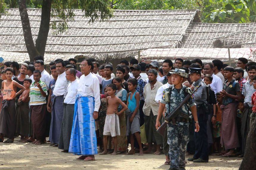 Members of minority Muslim Rohingyas gather for the arrival of a delegation of UN officials and foreign diplomats in Ale Than Kyaw village in Maungdaw, Myanmar's Rakhine State on Nov 3, 2016.