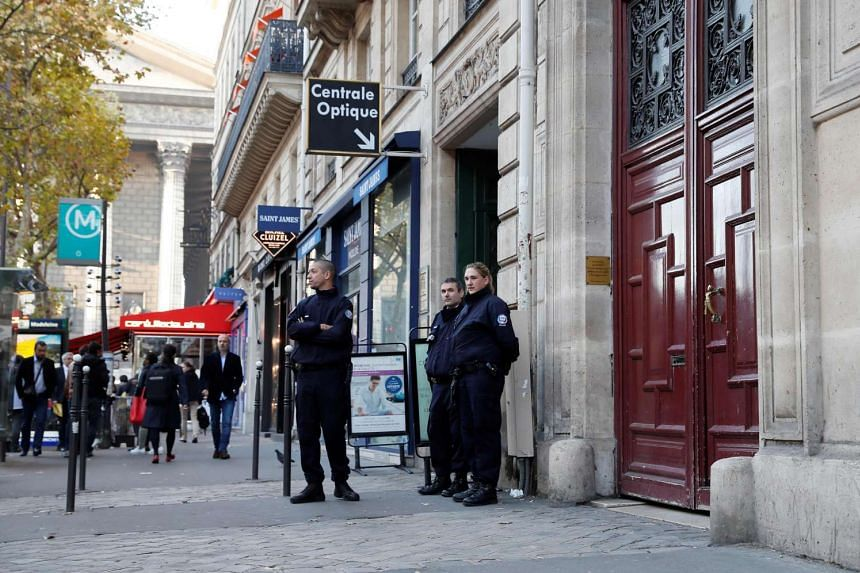 Police officers standing guard at the entrance to a hotel residence at the Rue Tronchet on Oct 3, 2016, where Kim Kardashian was robbed at gunpoint by assailants disguised as police.