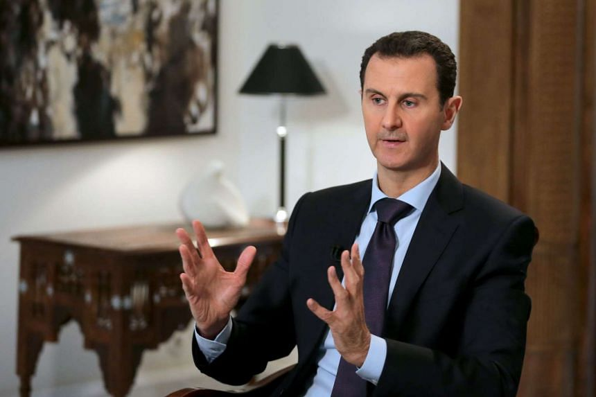 Syrian President Bashar al-Assad gesturing during an exclusive interview with AFP on Feb 11, 2016.