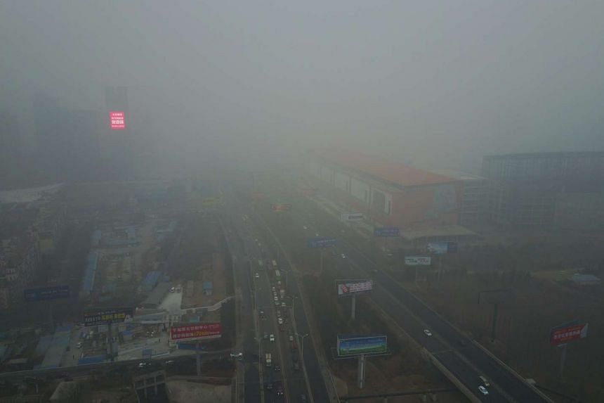 Buildings and roads are shrouded in smog in the Yanjiao district of Sanhe, Hebei province, on Jan 5, 2017.