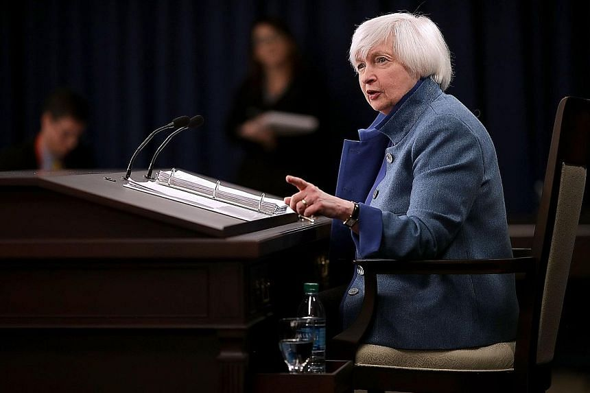 Dr Yellen (right) will host a town hall meeting with educators on Thursday but US President-elect Donald Trump's news conference the day earlier may have a greater impact on markets.