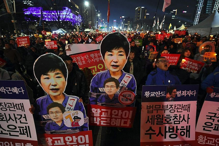 Protesters demanding the immediate resignation of President Park in Seoul last Saturday. As the Constitutional Court looks into whether to impeach Ms Park, her proposal over the presidency is ironically being debated.