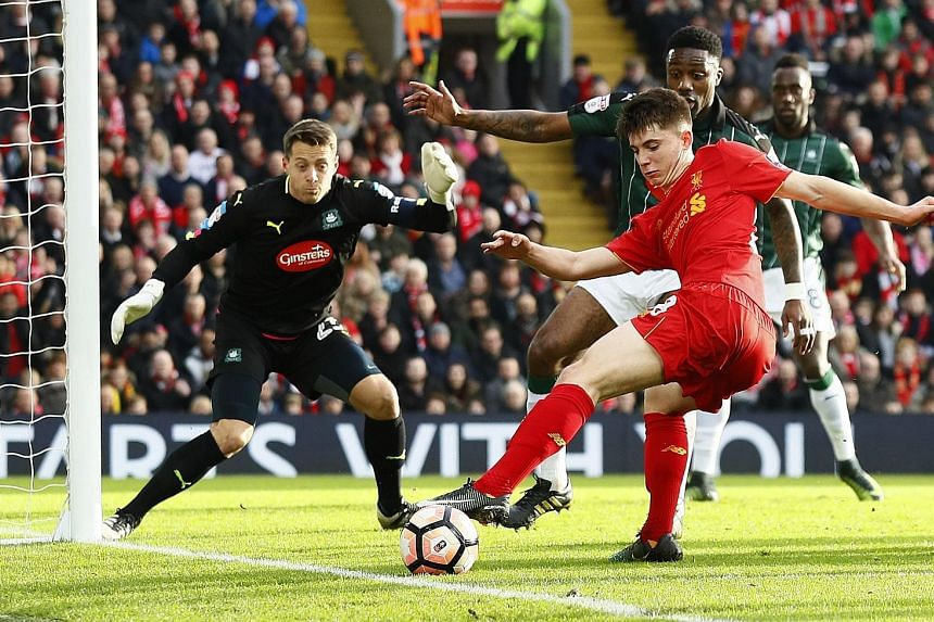 Liverpool's Ben Woodburn showing a pair of quick feet to carve out a chance at goal as the Plymouth defence closes in. The Reds academy product was one of the few bright spots in a game where clear-cut opportunities were hard to come by.