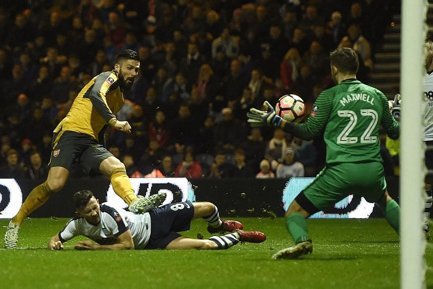 Arsenal striker Olivier Giroud scoring the 89th-minute winner against Preston in the FA Cup third round. His goal completed a 2-1 comeback win for the Gunners.