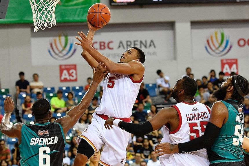 Singapore Slingers' Xavier Alexander attempts to score against the Malaysia Dragons in a thrilling Asean Basketball League (ABL) game at the OCBC Arena yesterday. In a nail-biting game, which went into double overtime, the hosts clawed back from 72-7