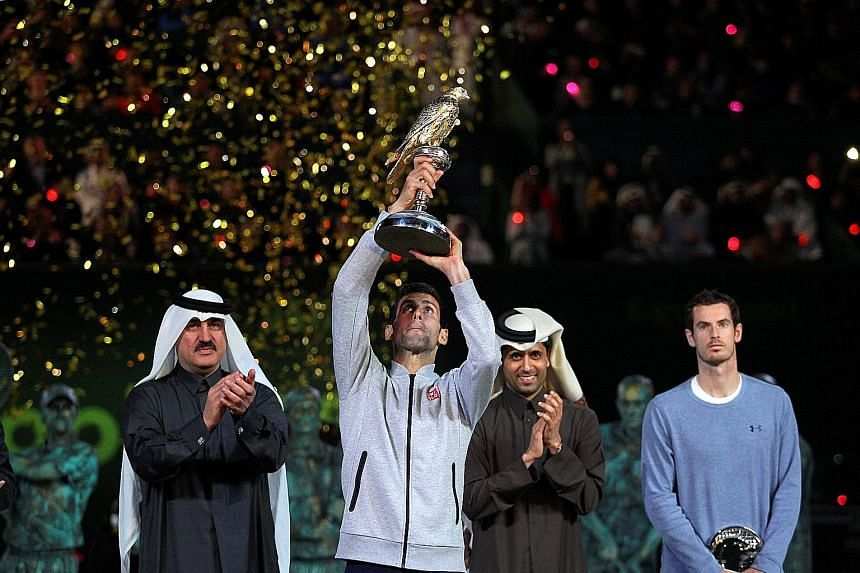 Novak Djokovic lifts the Qatar Open trophy after defeating world No. 1 Andy Murray 6-3, 5-7, 6-4. The Serb has never lost to Murray after winning the opening set.