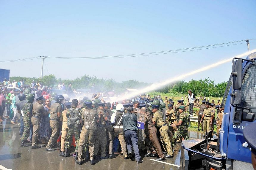 Police clashing with protesters who claim thousands of families will be evicted to provide land for a planned industrial zone for Chinese investors, in Hambantota, Sri Lanka, on Saturday.
