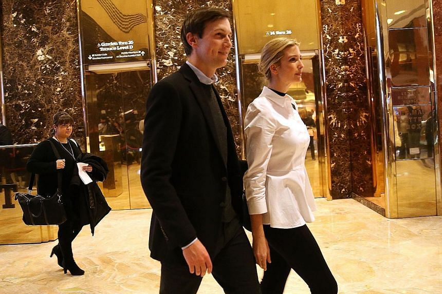Mr Kushner and his wife Ivanka in the lobby of Trump Tower. He is said to be considering a position in his father-in-law's White House administration, but experts say that such an appointment would draw legal challenges over potential violation of a