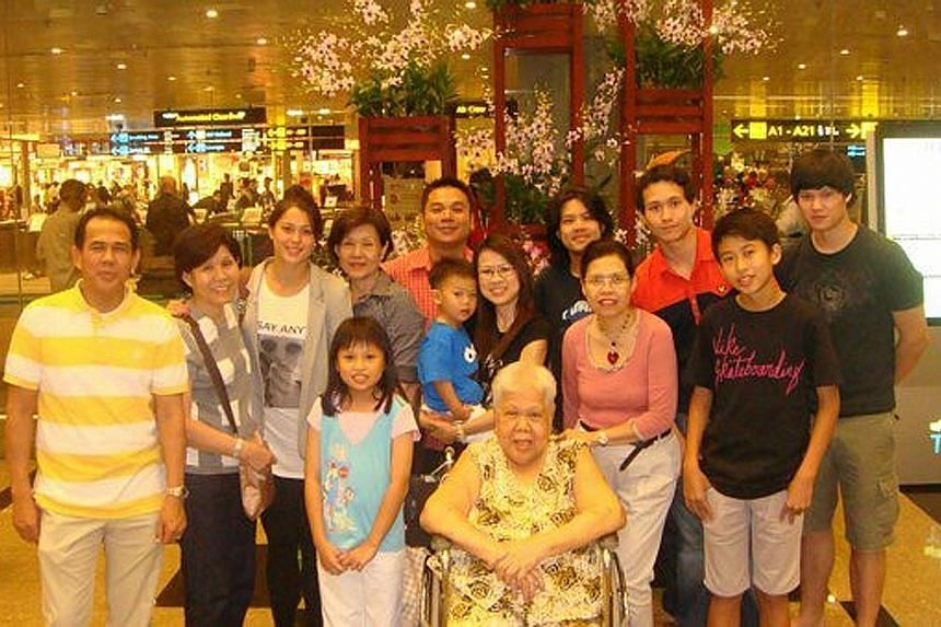 Left: Sam Quek (third from left) with some of her Singapore family at Changi Airport in 2010. Her brothers - Michael (third from right) and Shaun (extreme right) - also made the trip to their father's native country that year. Below: Marilyn and Albe