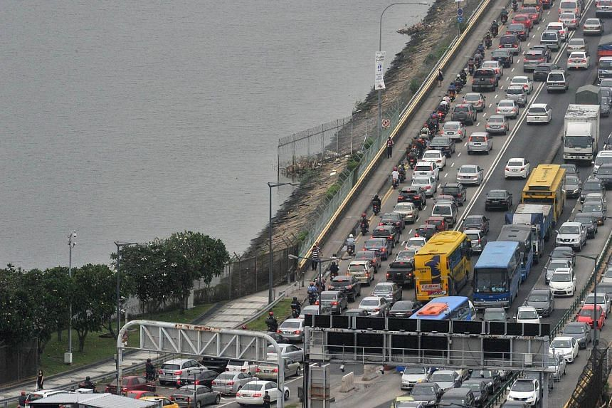 File photo of traffic at the Woodlands checkpoint. Singaporean motorists are responsible for most of the 275,663 unpaid summons in Malaysia.