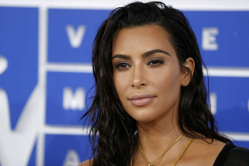 French police have arrested several people and detained others for questioning in connection with the robbery of Kim Kardashian in Paris last year.