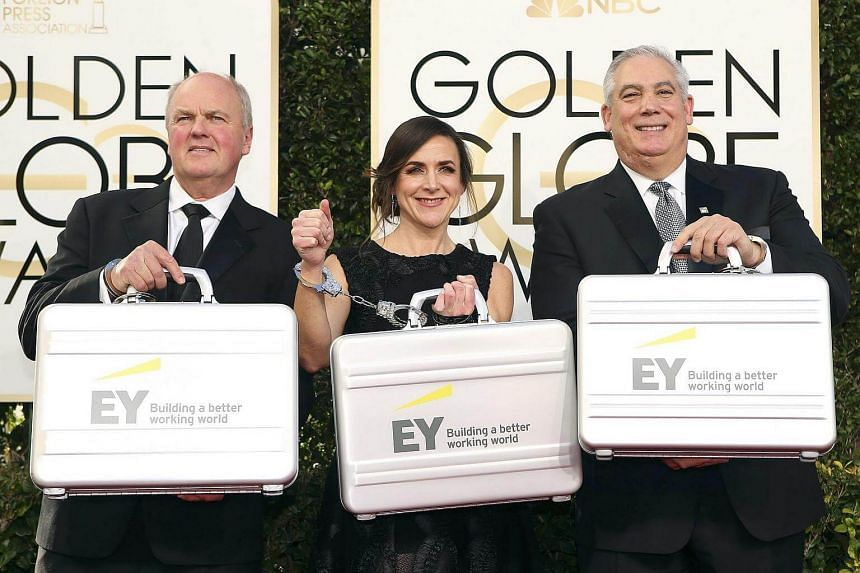 Representatives from Ernst & Young hold briefcases as they arrive at the 74th Annual Golden Globe Awards in Beverly Hills, California, US, on Jan 8, 2017.