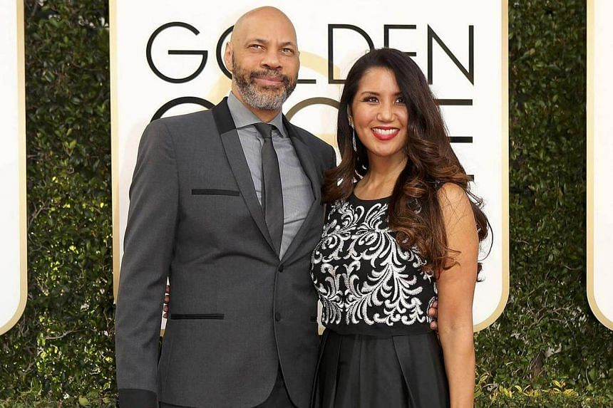 Writer and producer John Ridley (left) and his wife Gayle Ridley arriving at the 74th Annual Golden Globe Awards in Beverly Hills, California, US, on Jan 8, 2017.