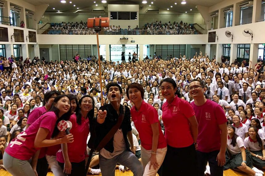 Singer Nathan Hartono charms the students from St Margaret's Secondary School in his new role as a campaign ambassador for the Committee to Promote Chinese Language Learning.