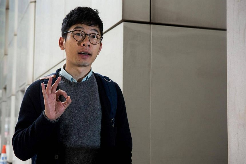 Legislative Council member Nathan Law gestures as he arrives at the High Court for a mention to appeal his conviction for his involvement in a protest that led to mass pro-democracy rallies in Hong Kong on Jan 5, 2017.