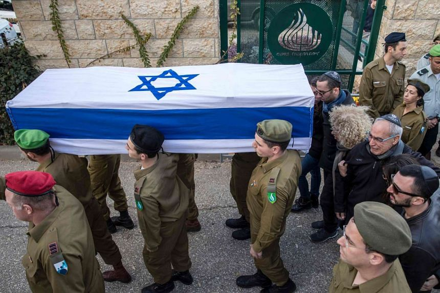 Israeli security forces carry the coffin of 20-year-old Israeli soldier Yael Yekutiel, who was killed in the truck ramming, on Jan 9, 2017 during her funeral in Tel Aviv