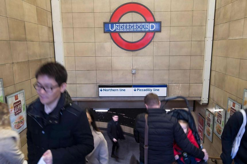 People pass through Leicester Square underground station in central London on Sunday (Jan 8, 2017).