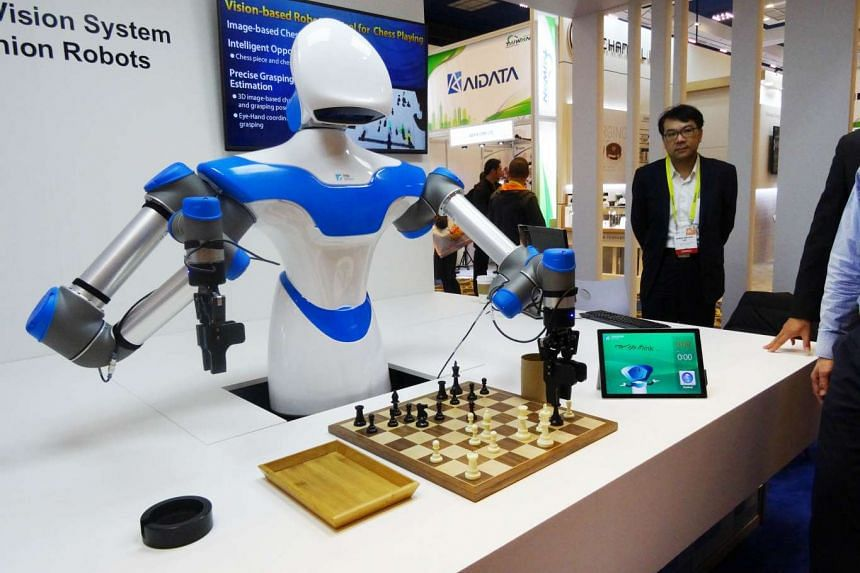 A robot developed by Taiwan engineers moves chess pieces on a board at the 2017 Consumer Electronic Show (CES) in Las Vegas, Nevada on Sunday (Jan 8, 2017).