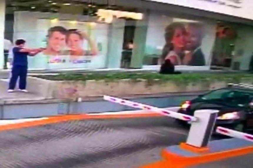 A man shoots at a US consular official in his car in Guadalajara, Mexico, in this still image taken from a Jan 6, 2017 security video footage released by the US Embassy in Mexico.