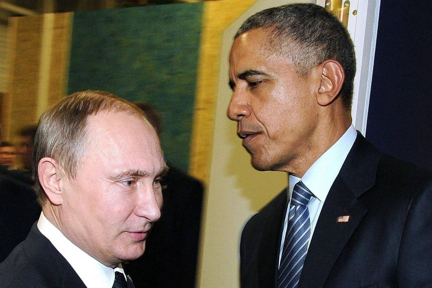Russian President Vladimir Putin (left) meeting with US President Barack Obama on the sidelines of the UN conference on climate change - COP21 in Le Bourget, on Nov 30, 2015.