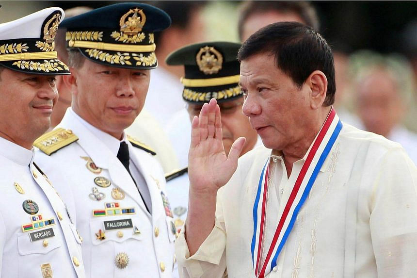 President Rodrigo Duterte returning the salute of a military officer (not pictured) as he leads the death anniversary celebration of Filipino national hero Dr Jose Rizal in Manila, Philippines, on Dec 30, 2016.
