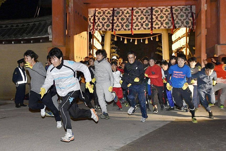 """The """"Lucky Man Run"""" harks back to a tradition started in the 14th century when locals hurried to the Nishinomiya shrine in Hyogo Prefecture on this day to offer prayers for prosperity."""